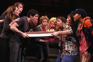 Photo Op - Avenue Q plays 1,500 performance - cast blows out cake candles