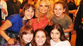 Look at those happy faces! Kristin Chenoweth pauses to greet young admirers from the Broadway Dreams Foundation.