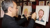 Joe Mantello snaps a shot of pal John Benjamin Hickey's caricature for his personal collection.