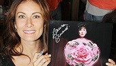 Laura Benanti holds up a piece of theater history—a portrait of the star as Gypsy Rose Lee in Gypsy!