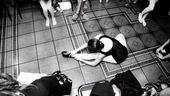 Billy Elliot Ballet Girls Open Call – b&w girl stretching on a tile floor