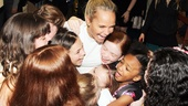 It's Tony winner (and Annie movie alum) Kristin Chenoweth! Here, Cheno gives the girls a big group hug. Aw!