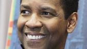 Denzel Washington beams on press day.