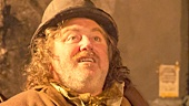 Pat Shortt as Johnnypateenmike & Daniel Radcliffe as Cripple Billy in The Cripple of Inishmaan