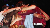 After a stirring performance, the cast of Godspell circles Corbin for a group hug!