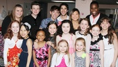 Kristin Chenoweth and the stars of Glee? This is the orphans best night ever! Glee stars Ashley Fink, Chris Colfer, Kevin McHale, Darren Criss, Jenna Ushkowitz and Alex Newell join the young ladies for a photo.