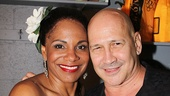 Audra McDonald welcomes designer Carmen Marc Valvo backstage.